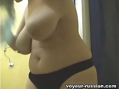 Candid voyeur bag Russian girl playing with huge fake tits