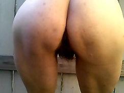 Asian milf showering her hairy muff outdoors
