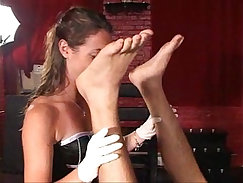 Asian mistress gives head to strapon