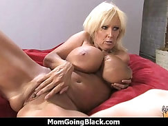 Busty cougar eats white big rod after sex