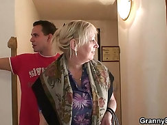 Busty granny and young guy play