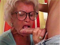 Grey light granny gets a good dick to suck under her boner